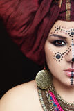 Face paint. Close-up portrait of young beautiful woman with traditional Berber face paint and turban royalty free stock images