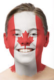 Face paint - flag of Canada. Girl with face paint of flag of canada on her face royalty free stock photo