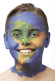 Face paint - South America. Face paint : girl with map painted on her face isolated on white royalty free stock photo