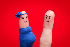 Face painted on fingers. The man was upset because the woman is pregnant.  royalty free stock images