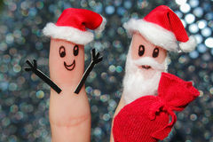 Face painted on the fingers. Santa Claus gives gifts Royalty Free Stock Images