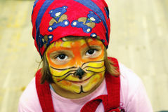 Face-painted little girl smiling royalty free stock images