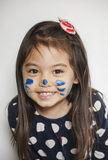Face painted by mommy Stock Photos