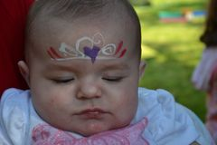 Face Painter baby girl princess pink Royalty Free Stock Images