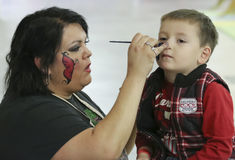 A Face Painter at T-Rex Planet, Tucson Expo Center Stock Image