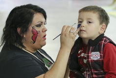 A Face Painter at T-Rex Planet, Tucson Expo Center Royalty Free Stock Photos