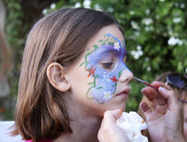 Face painting. A caucasian child having her face painted Stock Photography