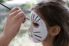 Face painting. Girl get her face painted Royalty Free Stock Image