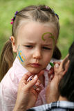 Face painting. Five years old girl face painting stock images