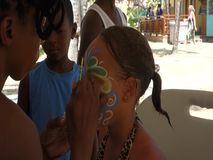 Face painting at an annual event in the windward islands
