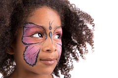 Face painting, butterfly. Beautiful young girl with face painted like a butterfly royalty free stock photography