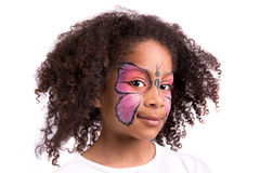 Face painting, butterfly. Beautiful young girl with face painted like a butterfly stock photos