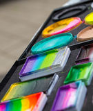 Face painting cosmetics. Color cosmetics, brushes and sponges for face painting. Children party stock images