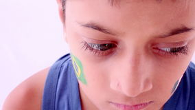 Face painting flag of Brazil and France stock footage