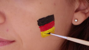 Face painting flag of German stock video