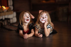 Face painting girls cats dark background, concept of holiday dar Royalty Free Stock Image