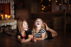 Face painting girls cats dark background, concept of holiday dar Royalty Free Stock Photography