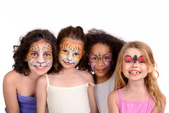 Face painting group. Beautiful young girls with animal painted faces stock photo