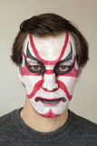 Face painting kabuki. Severe man with face painting kabuki black red and white color stock photos