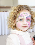 Face painting portrait. Portrait of a caucasian child with her face painted with a butterfly Stock Photos