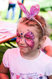 Face-painting. Small girl with painted face stock photos