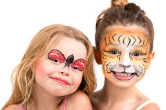 Face painting, tiger and ladybug Royalty Free Stock Photos