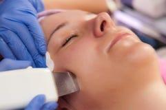 Face peeling. Woman in beauty salon, having her face peeling Royalty Free Stock Image