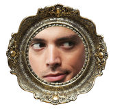 Face in picture frame Stock Photography