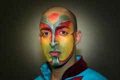 Face pintada Le Cirque du Soleil, executor Imagens de Stock