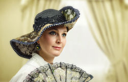 Face portrait of adult woman in vintage hat stock image