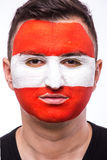 Face portrait of Austrian football fan support Austria national team Royalty Free Stock Image