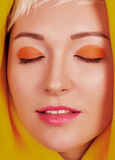 Face portrait of beautiful young woman with colorful make-up Stock Image