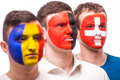 Face portrait of football fans support their national team: Romania, Albania, Switzerland Royalty Free Stock Image