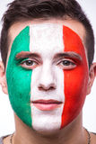 Face portrait of Italian football fan support Italy national team on white background. Stock Photo