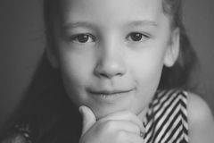 Face portrait of little cute happy girl, black and white. Face portrait of little cute happy girl, smiling and posing, closeup, black and white Stock Photography