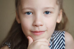 Face portrait of little cute happy girl, smiling and posing. Closeup Stock Photography
