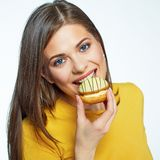 Face portrait of smiling woman biting cake. stock photo