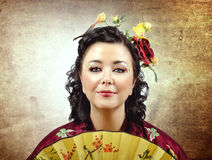 Face portrait of a stylized kimono woman with fan Stock Photography