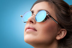 Face portrait of young beautiful woman in round sunglasses royalty free stock photos