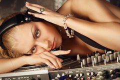 Face portrait of young blonde thoughtful lady DJ. At night club Stock Photo