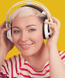 Face portrait of young woman with headphones Stock Images