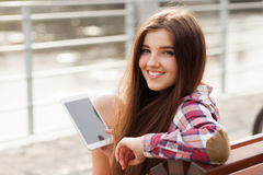 Face portrait of young woman using a tablet pc Stock Images