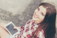 Face portrait of young woman using a tablet pc Stock Image
