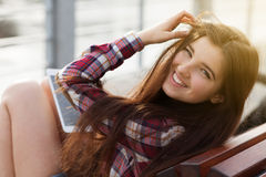 Face portrait of young woman using a tablet pc royalty free stock image