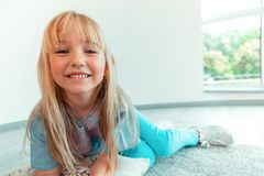 Face of a positive nice blonde girl. Carefree child. Face of a positive blonde girl while smiling to you royalty free stock photos
