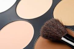 Face-powder. Box and black single brush stock photo