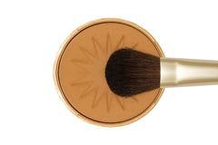 Face powder. Sun tanning face powder with brush stock photos