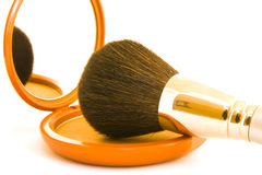 Face Powder with Brush. Bronze face powder in a compact with brush on a white background stock photography