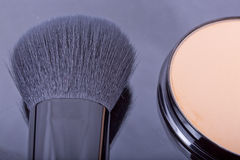 Face powder with a brush close up Royalty Free Stock Photo