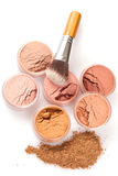 Face powder colors and brush Stock Images